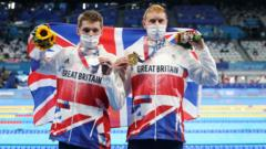 Silver medalist Duncan Scott of Team Great Britain and gold medalist Tom Dean of Team Great Britain pose with their medals for the Men's 200m Freestyle Final