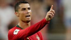 Portugal's Cristiano Ronaldo reacts while a incident is reviewed by the Video Assistant Referee