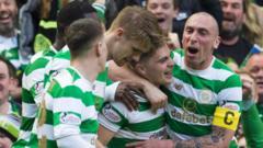 Celtic players celebrate against Rangers