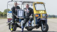 Matt Everard (right) and passenger Russell Shearman celebrate their Guinness World Record after setting the world land speed record in a tuk tuk at Elvington Airfield