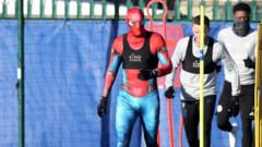 A football player dressed as Spiderman