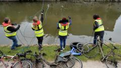 people fish bikes from canal