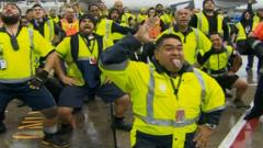 Airport staff in tarmac haka