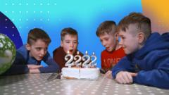 quadruplets-blow-out-candles-on-their-birthday-cake.