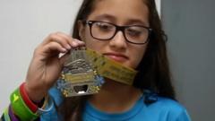 Lee holding her medal