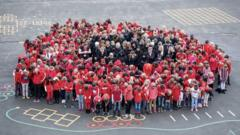 West Ewell Primary School in Surrey gathered in the shape of a poppy to mark the WW1 centenary