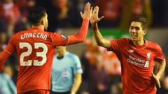 Roberto Firminho (right) celebrates his goal with Emre Can