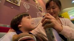 Li Tianqin gives her daughter canned air from the Canadian Rockies