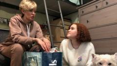 Anastasia Shevchenko prepares a bag for prison with her daughter