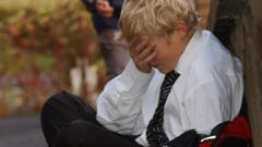 Posed photograph simulating a child being bullied bullying