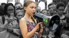 greta-thunberg-with-megaphone-in-crowd