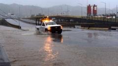 A truck drives along a flooded street in Manzanillo