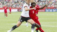 "England's Eniola Aluko and Germany""s Melanie Leupolz at the Women""s World Cup 2015"