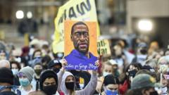 Protesters march through downtown Minneapolis on the first day of opening statements for the murder trial of former Minneapolis police officer Derek Chauvin who was charged in the death of George Floyd, in Minneapolis, Minnesota, USA, 29 March 2021.