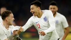 Jesse Lingard celebrates 0-1 during the International Friendly match between Holland v England in his England kit