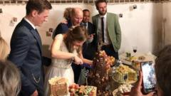 Martha cutting the cake at her wedding