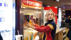 Brie Larson served popcorn at the cinema