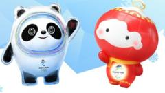 Panda named Bing Dwen Dwen, the official mascot for the Beijing 2022 Olympic Winter Games, and glowing lantern Shuey Rhon Rhon, the official mascot for the Paralympic Winter Games.