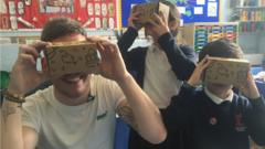 Martin and pupils using VR headsets