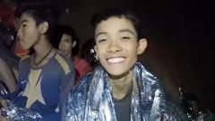 A video grab handout made available by Thai Royal Navy shows some of the members of a trapped soccer team