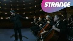 An orchestra and strange logo