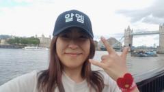 Reis in London, wearing RM hat in front of London Bridge.