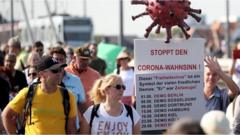 People carrying placards as they take part in an anti-coronavirus restrictions march