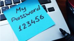 Password '123456' written on a blue note