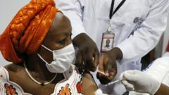 An Ivorian woman receives the first injection of the Covid-19 vaccine, at a vaccination center in Abidjan, Ivory Coast, 01 March 2021.