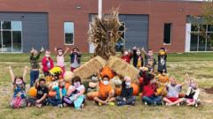 Children in front of their fall display.