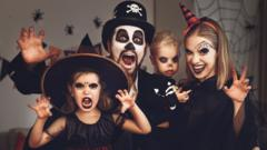 Generic family in Halloween costumes and makeup. Posed by models.
