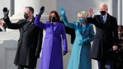 President-elect Joe Biden, his wife Jill Biden, Vice President-elect Kamala Harris and her husband Doug Emhoff salute as they arrive ahead of the inauguration of Biden, in Washington