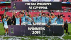 Manchester City players celebrate with the Trophy after Women's FA Cup Final match between Manchester City Women and West Ham United Ladies