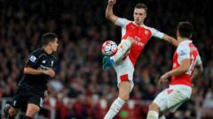 Arsenal's Calum Chambers reaches for the ball
