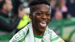Karamoko Dembele joined in the title celebrations after a 2-1 win over Hearts