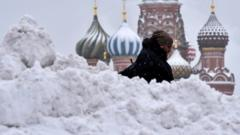 A man walks past Saint Basil's cathedral in central Moscow