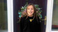a-girl-called-daisy-stands-outside-her-house