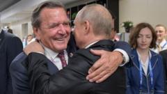 Gerhard Schröder hugs President Putin, Moscow, 14 June 18