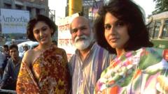 The fashion designer (centre) helped to modernise Indian fashion with pieces like the trouser sari