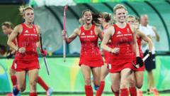Hollie Webb and Susannah Townsend celebrate scoring during the women's semi-final match