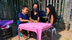 Eugenia Lima Silva, who was diagnosed with Covid-19 plays with her children
