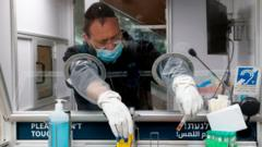 Israeli medic in PPE collecting test samples