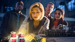 Undated BBC handout photo of Jodie Whittaker as The Doctor (centre), Bradley Walsh as Graham (second right) and Mandip Gill as Yaz (first right).