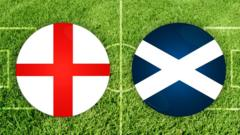 england and scotland flag on green pitch