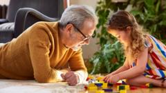 girl-and-granddad-playing-with-lego