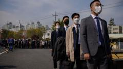 South Korean Jehovah's Witnesses and conscientious objectors to mandatory military service line up to enter a correctional facility to begin training as administrators, in Daejeon on October 26, 2020
