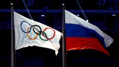 Russian and Olympic flag