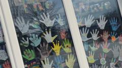 Cut-outs of hands in window