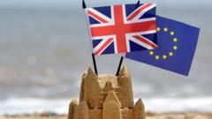 Sandcastle with union jack and EU flag