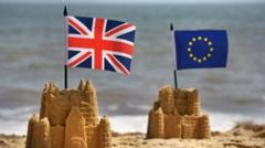 Sandcastles with british and EU flag